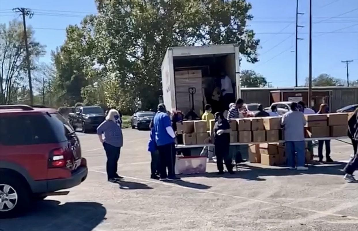 Sorting boxes at Farmers to Families Ensley event
